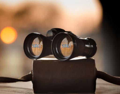 SRG logo being viewed through binoculars
